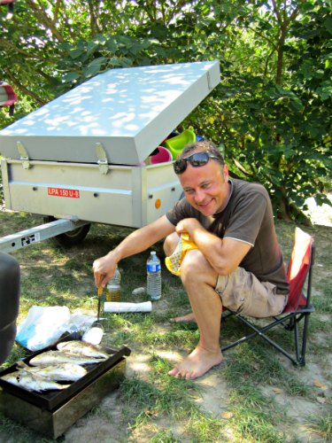 Using a portable camp grill for some grilled fish on the road!