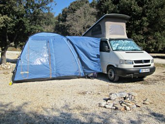 Drive away camper awning attached to the camper van