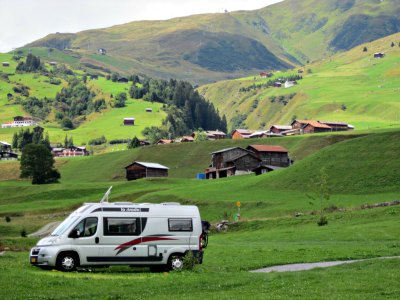 Camper van camping in the Swiss Alps.