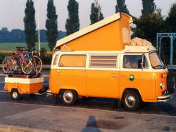 Volkswagen Westfalia Baywindow with a matching mini cargo trailer.