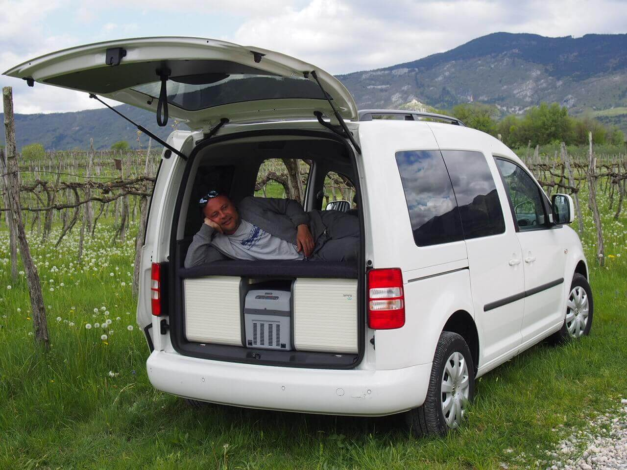 Volkswagen Caddy  small camper van conversion with a neat camping box.