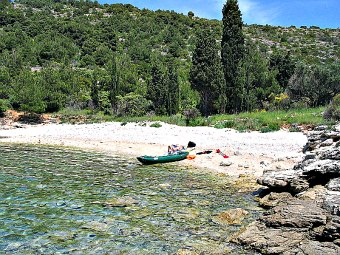 Sea kayakin around Croatia beaches.