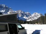 Cold weather camping in a camper van. Dolomite mountains, Italy