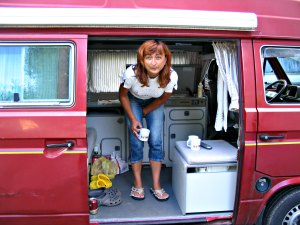 Girls camping - a woman camping out in her camper van