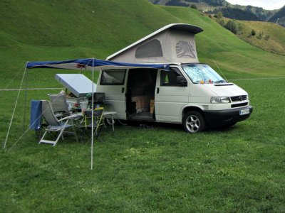 Homemade pop top camper on a Volkswagen van.