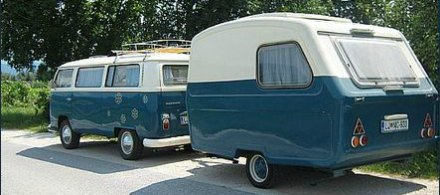 Small camping trailer matching with a Volkswagen Camper van.