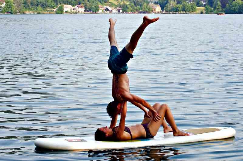 Practicing yoga on a paddle board.