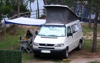 A practical sun shade camper awning on a Volkswagen camper
