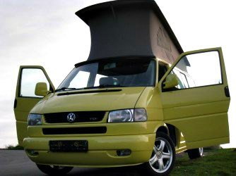 Volkswagen pop top camper van.