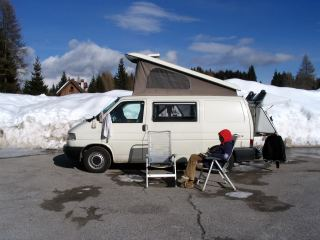 Enjoying the winter sunshine in front of our camper van.