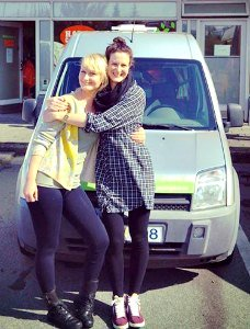 Young girls camping and traveling with a camper van rental