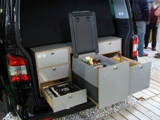 Using the rear part of a travel van for a mini kitchen/galley unit.